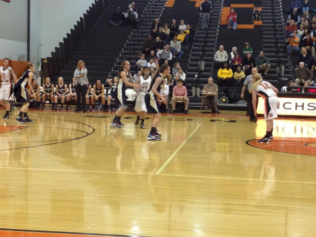 Abby Bender (12) sets up a play as point guard