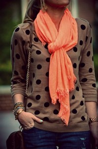 The colored scarf adds a nice hint of color to the neutral colored sweater.