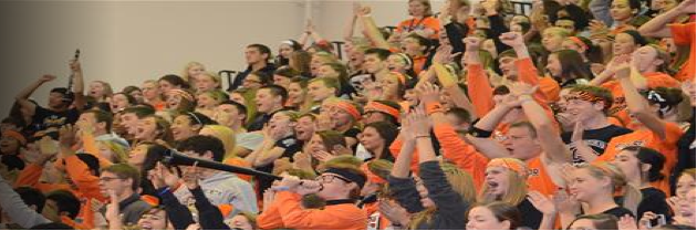 Excited students cheering at the annual homecoming pep rally.