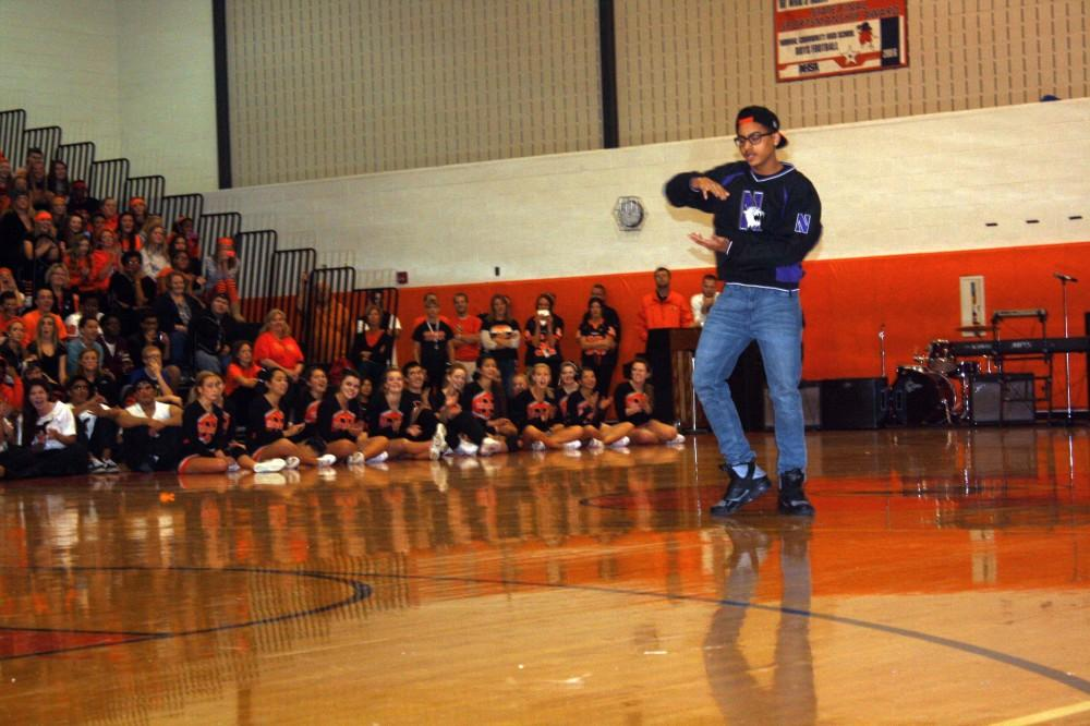 Jordan Stipp(10) performs a style of animation dance for the student body during the 2013 Homecoming assembly.