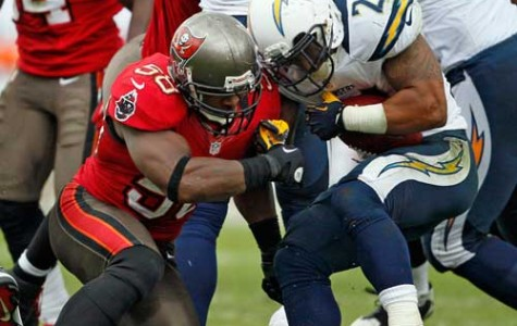 Tampa Bay Buccaneers linebacker Quincy Black (58) collides helmet to helmet with San Diego Chargers running back Ryan Mathews (24) in the third quarter at Raymond James Stadium in Tampa, Florida, Sunday, November 11, 2012. Black left the game on a backboard after a hit. The Tampa Bay Buccaneers defeated the San Diego Chargers, 34-24.