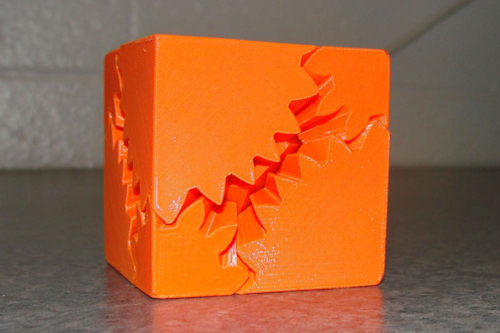 One of the many objects made my students at NCHS from the 3D printer. An orange cube that can transform into an irregular solid.