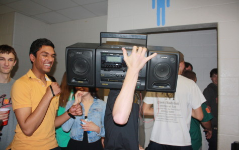Austin Bloom (12) carrying a boombox into the bathroom