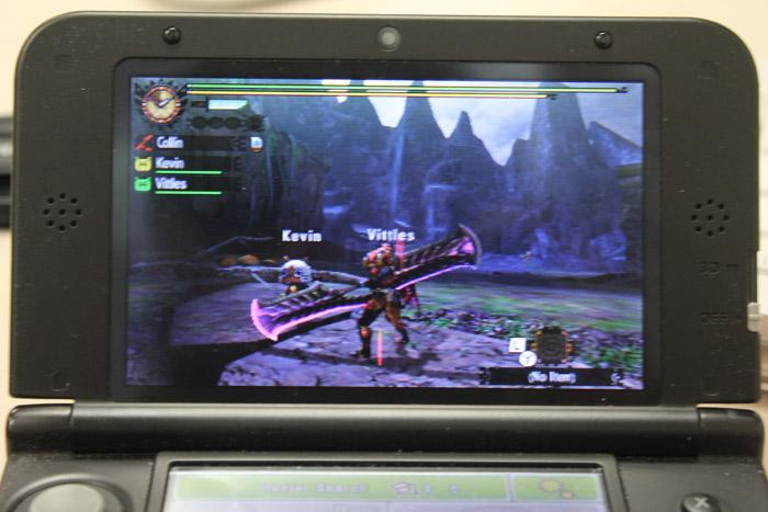 The titular monster hunter along side his two cat companions on a hunt in Capcom's Monster Hunter 4 Ultimate.