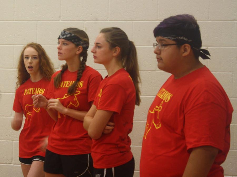 From Left: Emillee Miller(12), Alyssa Gourley(12), Hannah Thompson(12), Alejandro Bolanos (12) watching their teammates on the floor