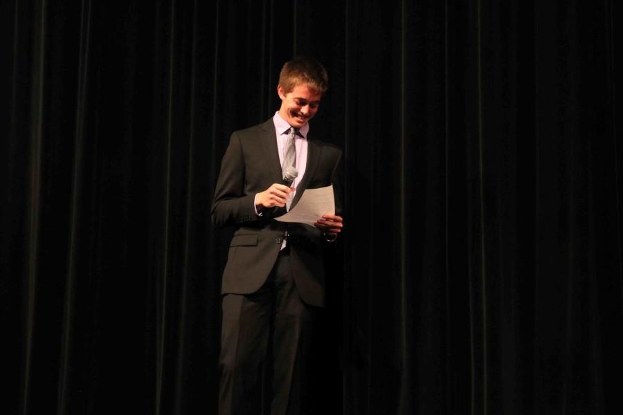 Senior Mitchell Turner reads a joke