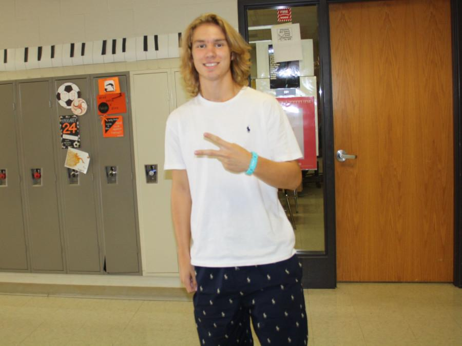 Ethan Neil throws the peace on Pajama Day.