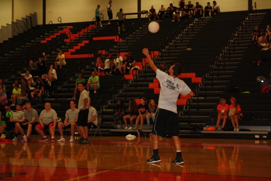 Dalton Bruso (12) serves the ball for the Average Joes.
