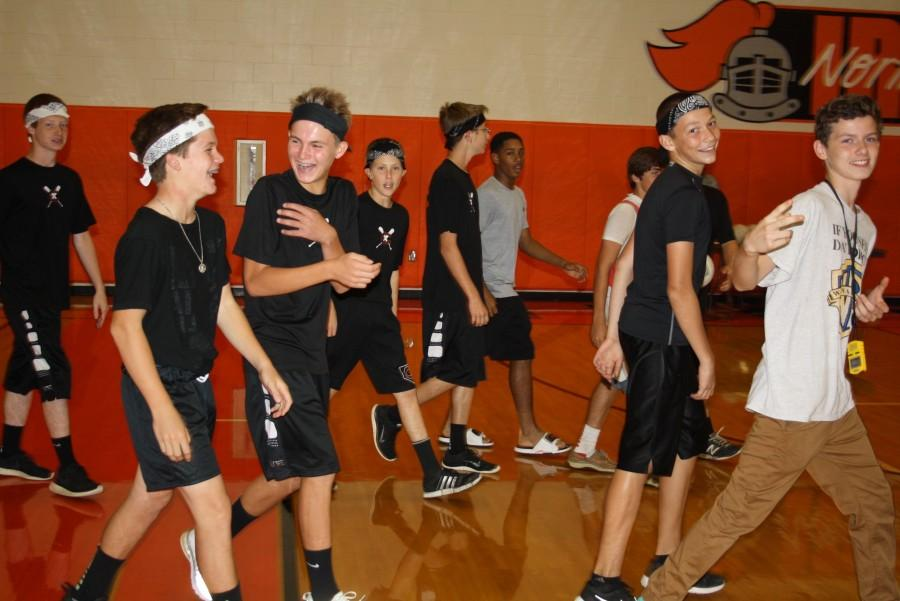 The SWAT Team (9) coming onto the court.