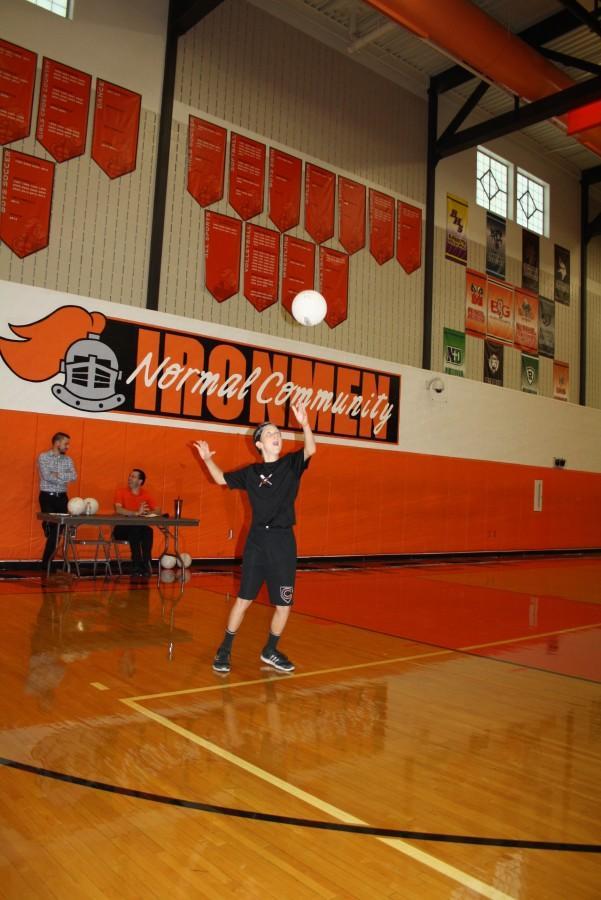 Denver Brant (9) serving the ball.