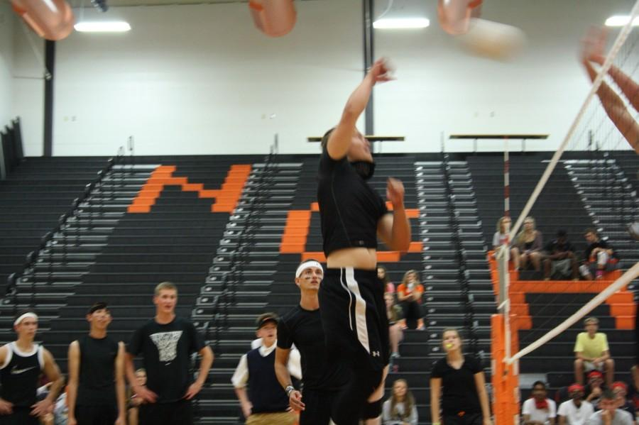 Alec Trela (12) spiking the ball for the Villains.
