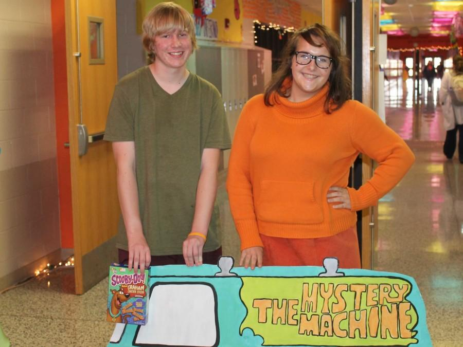 Evan Milsteadt (10) and Natalie Alfeo (11), dressed as two members of the Scooby Gang, snap a shot with their famous car.