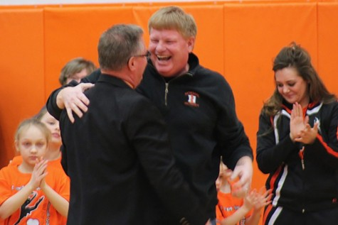 Principal Dave Bollmann embraces Andy Turner during the Feb. 12 basketball halftime ceremony honoring the Athletic Director's accomplishments.