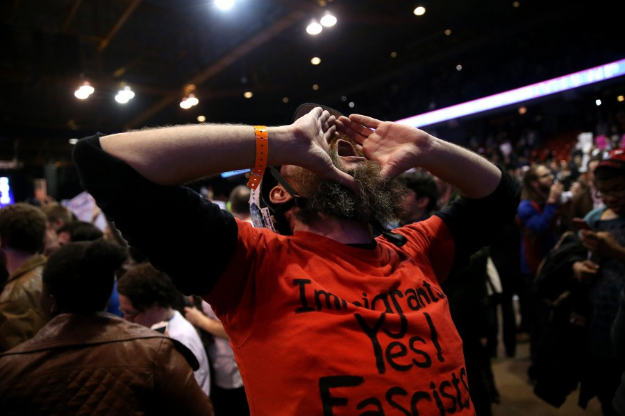 A protester celebrates after it was announced that the rally for Republican presidential candidate Donald Trump was cancelled at the UIC Pavilion in Chicago on Friday, March 11, 2016. (Chris Sweda/Chicago Tribune/TNS)