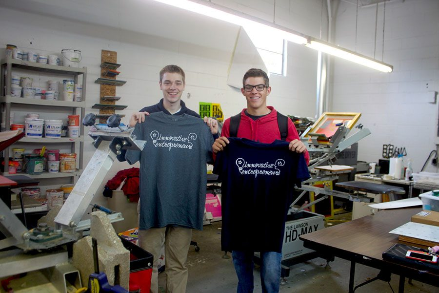 Nickolas Showalter and Tyler Smith learn to make t-shirts at Meltdown Creative Works.
