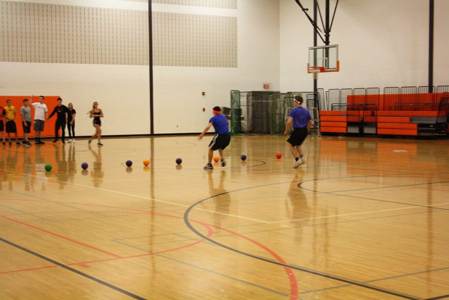 The game started and the first to reach the dodgeball's were Brady Lay(11) and Philip Fazio(11) of Mrs. Lopez team.