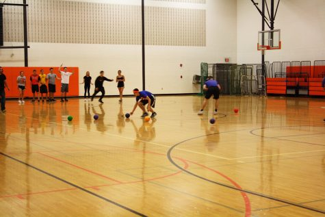 Using their strategy skills, Philip and Brady push the dodgeball's back to their teammates.