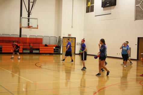 Mrs. Lopez's team gets focused into the game to try and get opponents out.