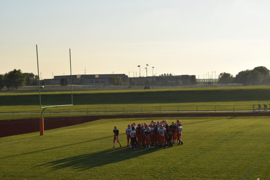 Sophomore players huddle before beginning the scrimmage.