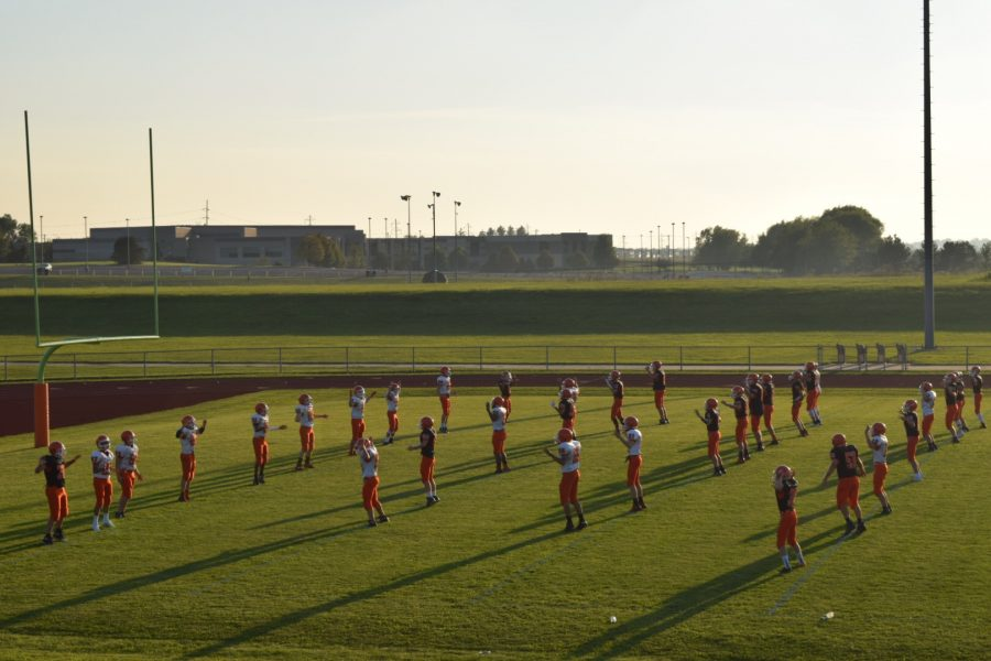 Sophomore players complete warm-ups before playing.