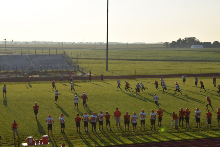 Freshman football players finish their scrimmage.