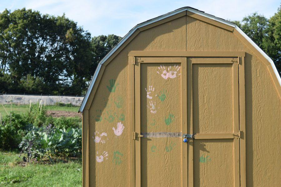 The garden shed is covered in handprints made by the children at the Boys and Girls Club.