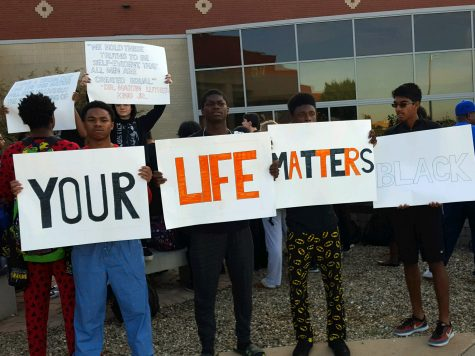 Students gather outside of the front of Normal Community, staging a rally Wednesday morning.