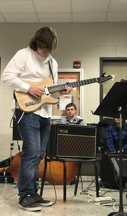 Adam Hintz (11),  previously the winner of the 2016-2017 Battle of the Bands, joins Jazz Band during the lunch hour performances.