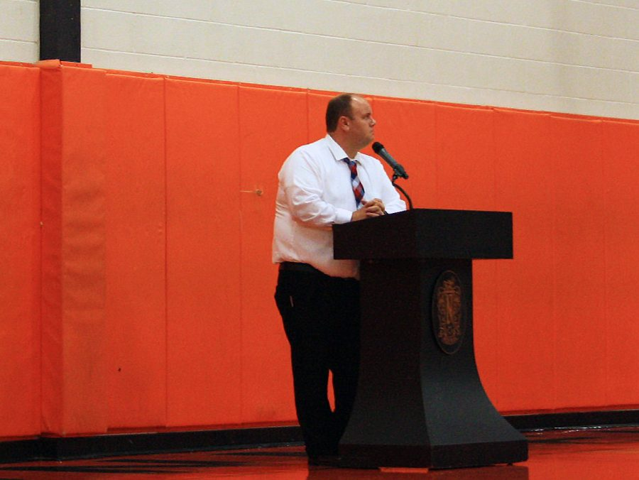 Mr. Trevor Chapman, after Mr. Dave Bollmann's retirement, addresses the student body during the all school assembly. Chapman's duties as NCHS principal began during the summer, but this was his first day as NCHS principal with students in attendance.