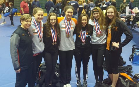Lady Iron Swim places 4th in State
