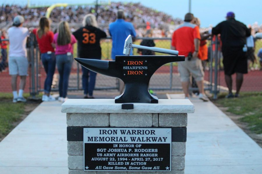 The memorial for Sgt. Josh Rodgers depicts the tools of iron forging; according to coaches, Josh embodied the Normal Community philosophy that