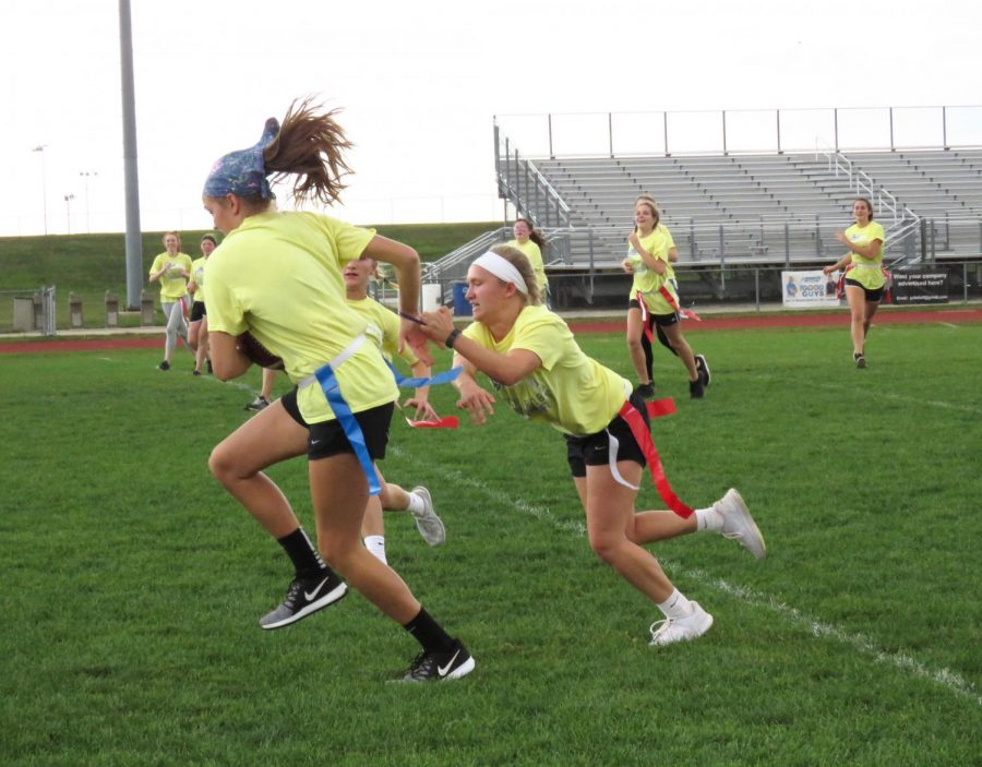Senior powder puff teams compete against each other.