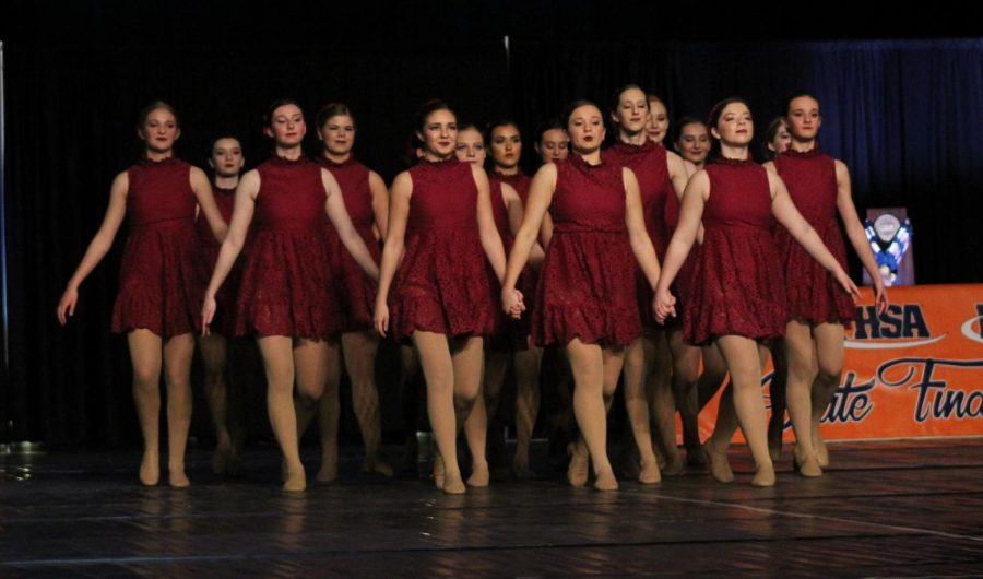 The+NCHS+dance+team+walks+out+onto+the+stage+at+the+IHSA+State+dance+competition