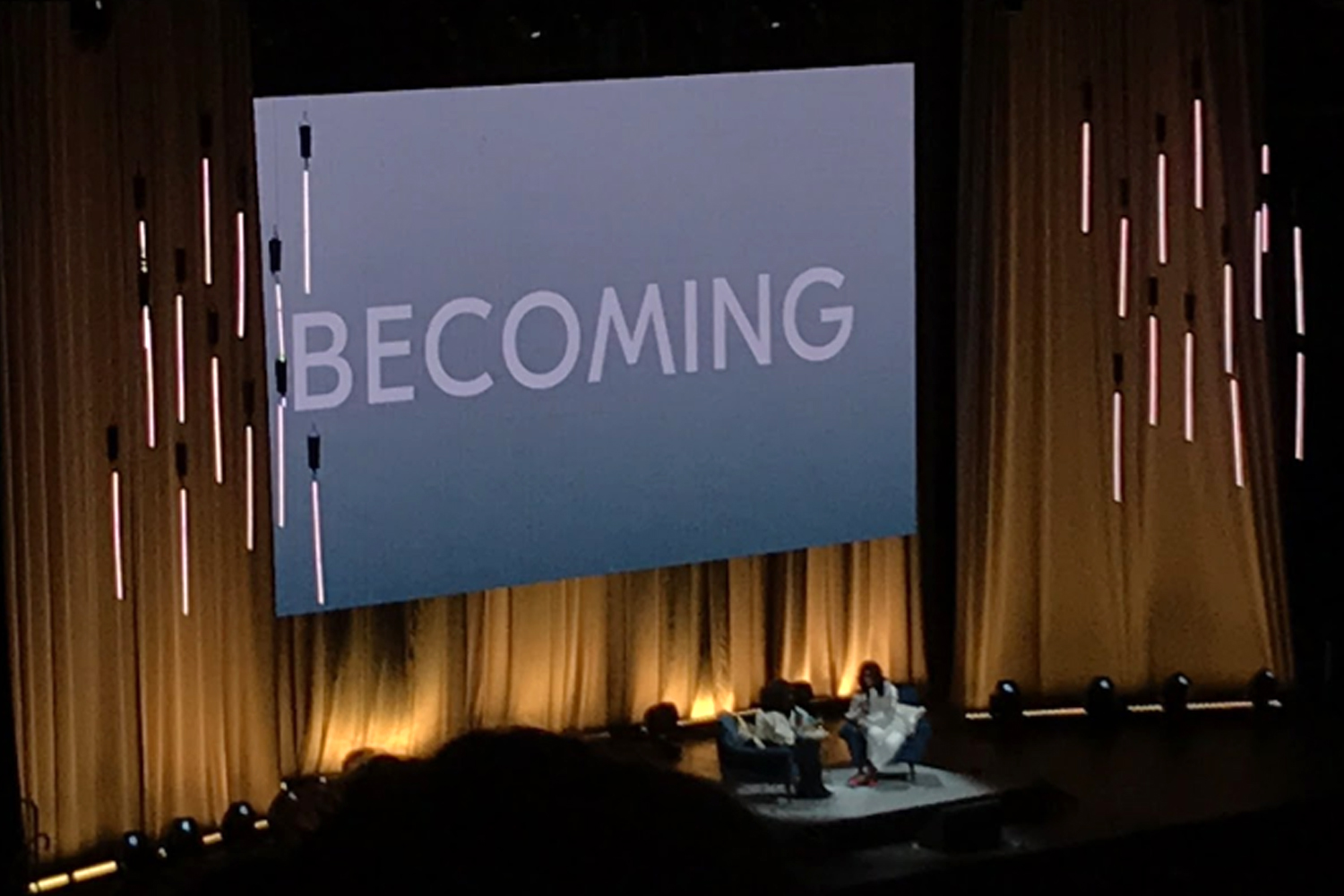 Michelle Obama and Oprah Winfrey on stage in Chicago at the United Center as they discuss Obama's new memoir.