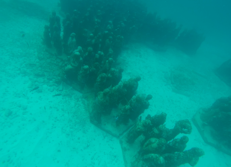 On the way to Isla Mujeres, stop to admire the breathtaking underwater museum
