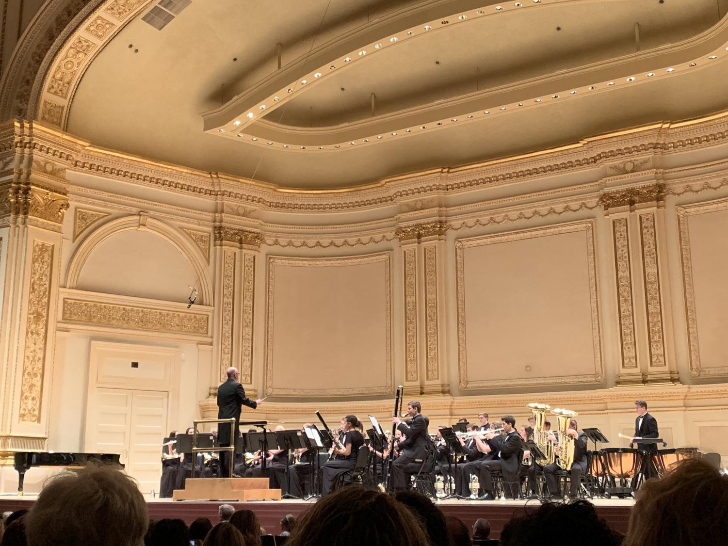 The Normal Community Wind Ensemble, directed by Mr. Lance Meadows, begins their performance at Carnegie Hall. ( Photo courtesy of NCHS Inkspot)