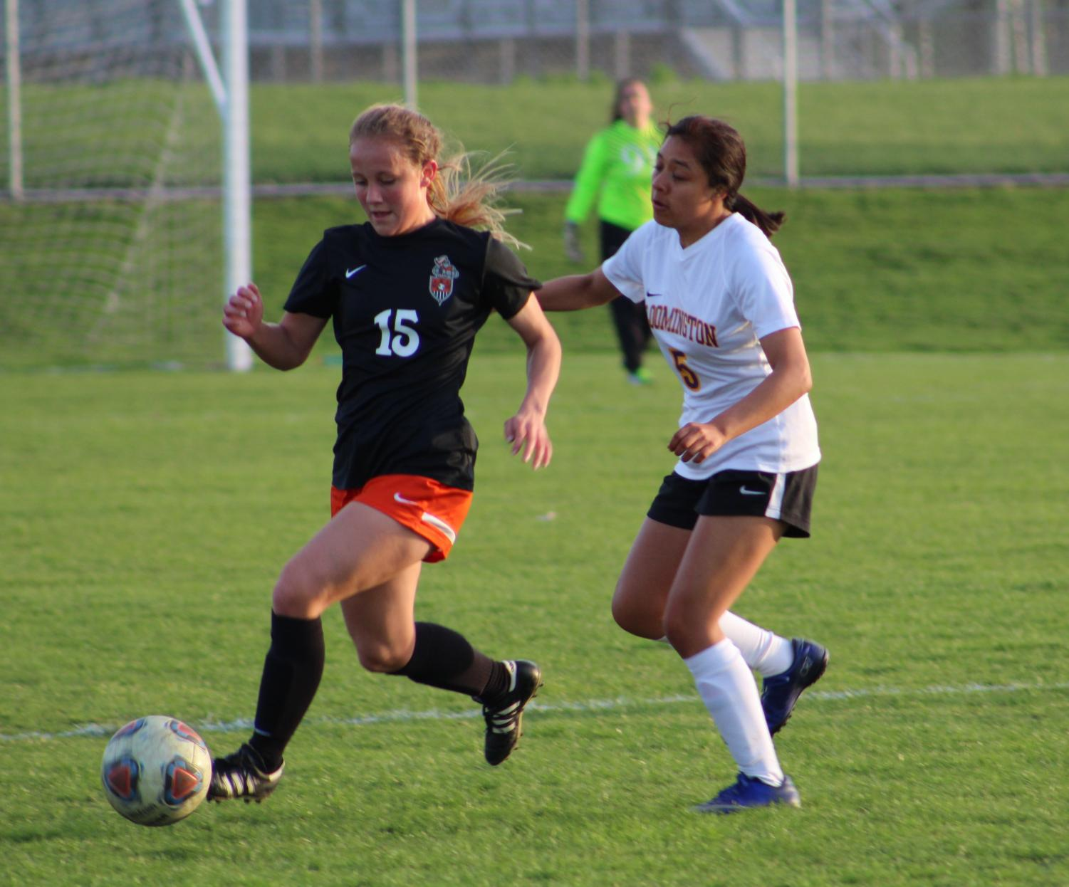 Katy+Quinn%2C+who+plays+defense%2C+keeps+the+ball+from+getting+into+the+other+teams+possession.+Quinn+plans+on+attending+Southern+Illinois+University.