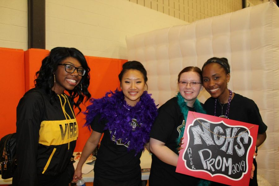 Students pose for a picture right before taking a picture in the photo booth.