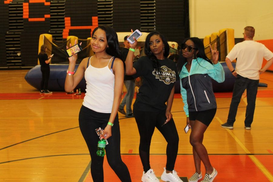 Students pose for a picture while taking a break from dancing.