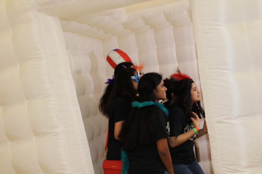 Students also posed for pictures in the photo booths in the big gym. Photo booths were at both Prom and After-Prom.