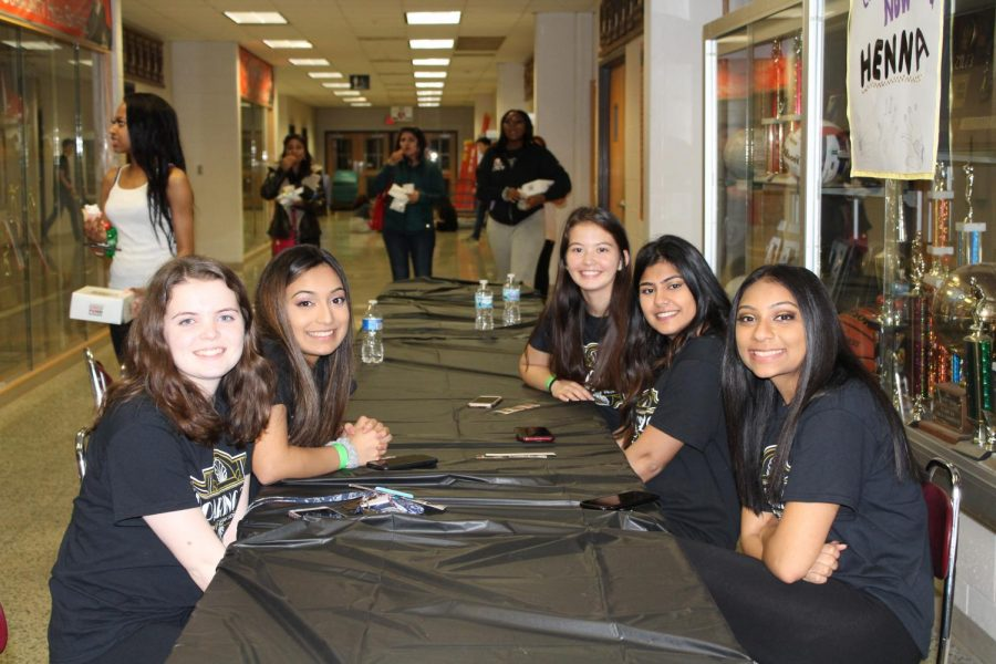 Students had the opportunity to get henna at this table earlier.