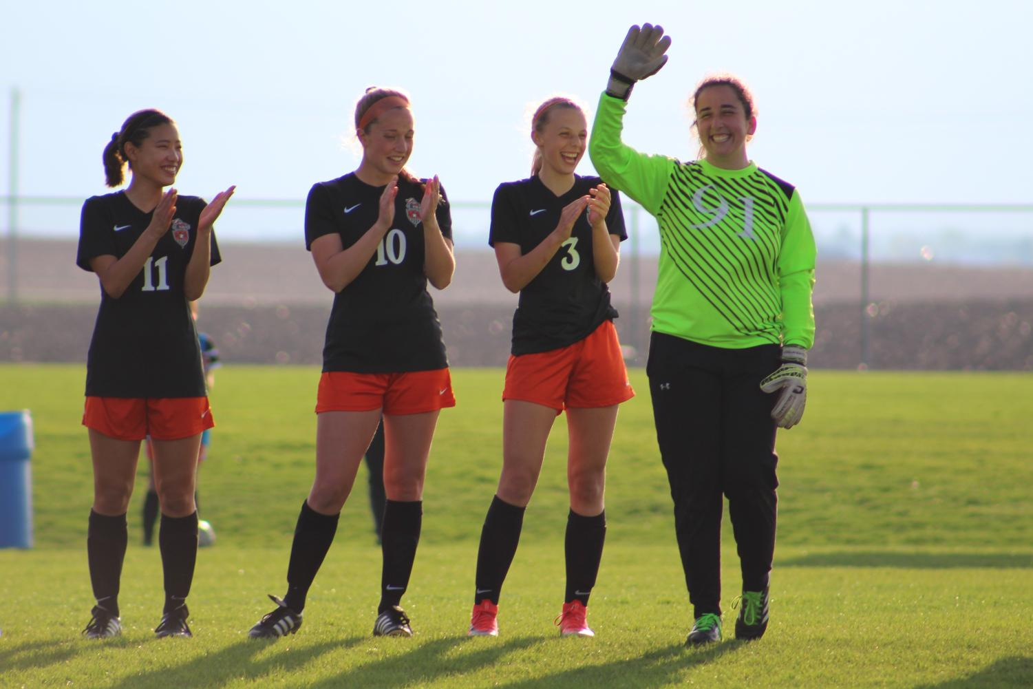 Goalkeeper+Savannah+Henson+waves+to+the+crowd+as+her+name+is+announced.+Henson+plans+on+attending+Illinois+college.