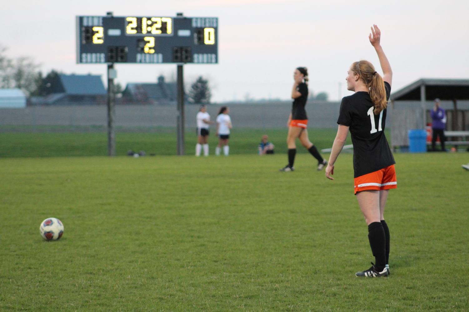 Maggie+Peters+prepares+to+kick+the+ball+following+a+penalty.