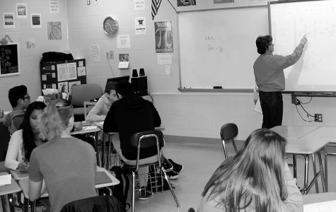 Mrs. Cathe Carter reviews a problem on the SmartBoard in her 3rd hour Honors Geometry class during her last semester teaching at NCHS.