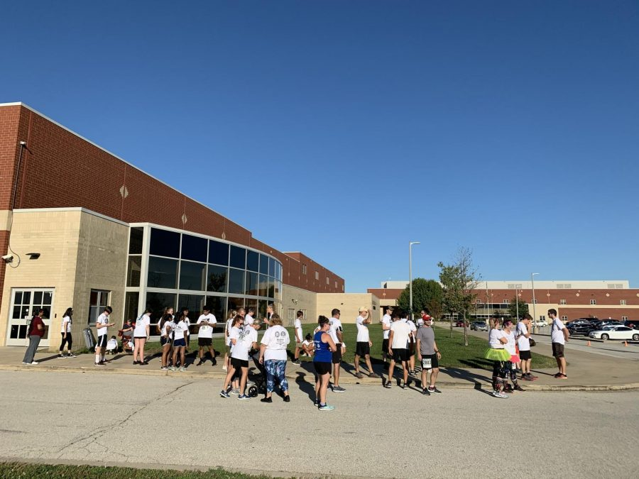 Runners prepare for the 5k color run by the swim doors.