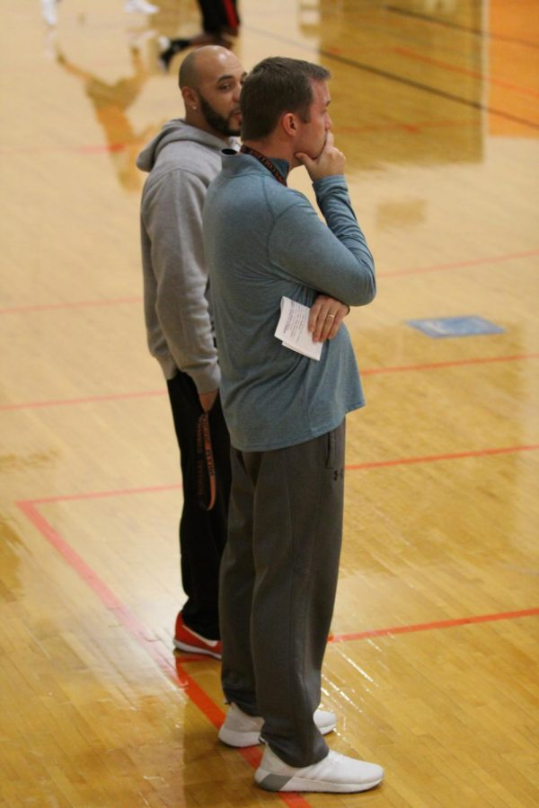 Head Coach Marcus Mann and Assistant Coach Dave Feeney watch a scrimmage early last season.