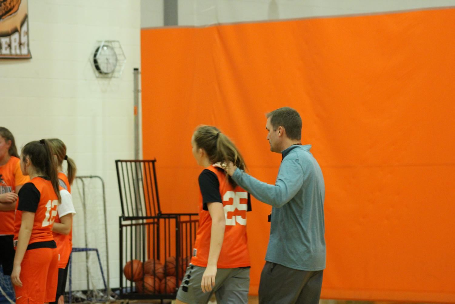 Feeney with then sophomore Maylin Henning during a practice early in the season last year.