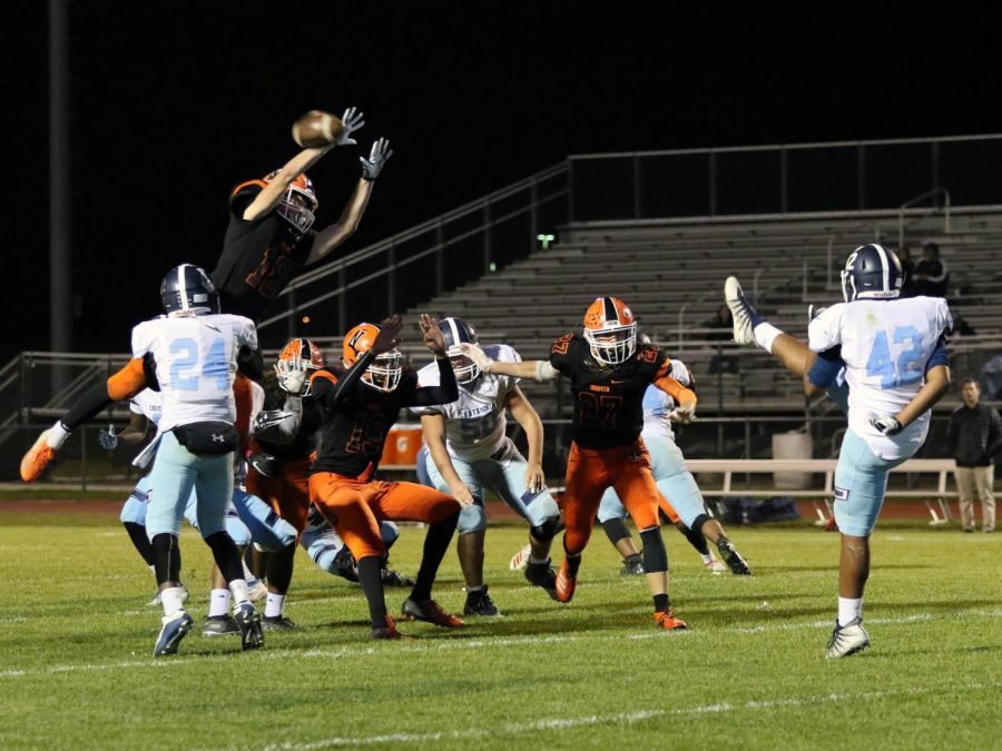 Junior Jude Lowery attempts to block the Centennial punt in the final minute of the 1st quarter.