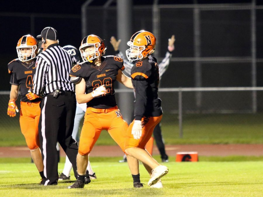 The turnover set up junior RB Ben Larsons 1st quarter touchdown run. Larson (28) celebrates as his score is signaled.