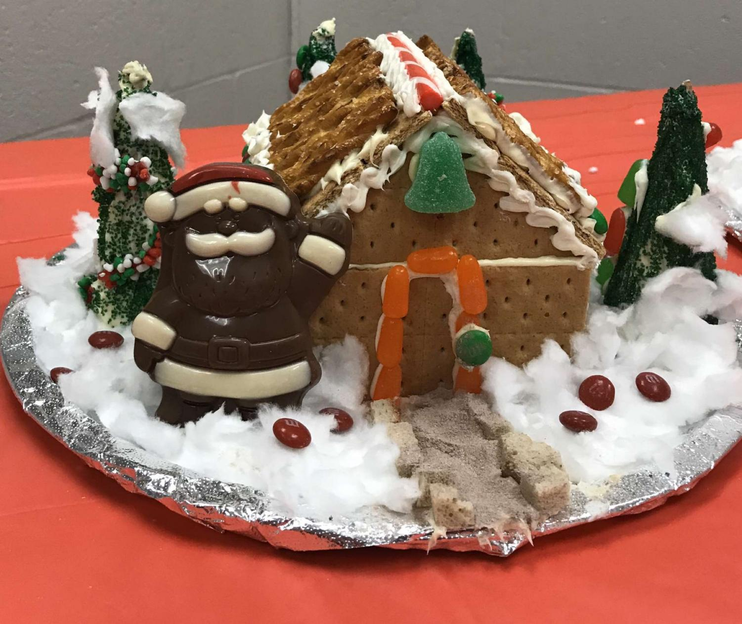 The first-place gingerbread house was constructed with a chocolate Santa and trees surrounding the structure.